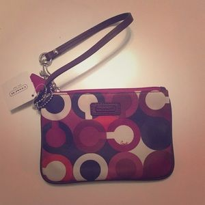 Never been used wristlet, tags still on it